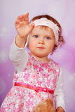 Adorable baby girl waving hand Stock Photography
