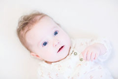Adorable baby girl wearing an elegant lace shirt Stock Photo