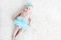 Adorable baby girl on white background wearing turquoise tutu skirt. Stock Photo
