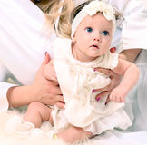 Adorable baby girl in white dress Royalty Free Stock Image