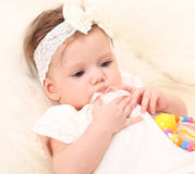Adorable baby girl in white dress Stock Image