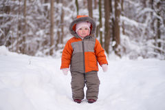 Adorable baby going through deep forest Royalty Free Stock Images