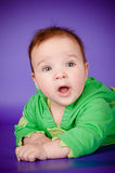 Adorable baby in a green costume Royalty Free Stock Images