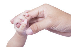 Adorable baby hand holds father finger Stock Photo