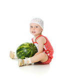 An adorable baby happily plays the watermelon Stock Photography