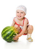 An adorable baby happily plays the watermelon Stock Image