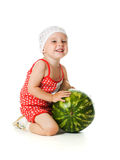 An adorable baby happily plays the watermelon Stock Photos