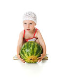 An adorable baby happily plays the watermelon Stock Images