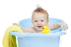 Adorable baby having bath in blue tub Stock Photo
