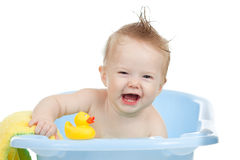 Adorable baby having bath in blue tub Stock Image