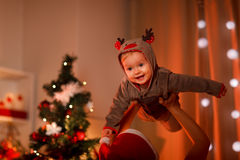 Adorable baby having fun near Christmas tree Stock Photography