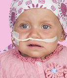 Adorable baby with a headscarf beating the disease Royalty Free Stock Photography
