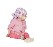 Adorable baby with a headscarf beating the disease Royalty Free Stock Photos