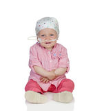 Adorable baby with a headscarf beating the disease. Isolated on white background Royalty Free Stock Photo