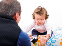 Adorable baby and her father Stock Photography