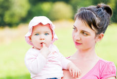 Adorable baby with her mother Stock Photos
