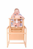 Adorable baby in high chair isolated Royalty Free Stock Photo