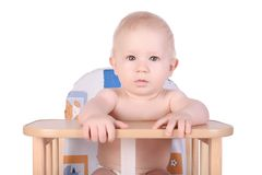 Adorable baby in high chair isolated Royalty Free Stock Image