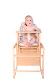 Adorable baby in high chair isolated Royalty Free Stock Photography