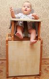Adorable baby on highchair, at home Royalty Free Stock Images