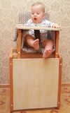 Adorable baby on highchair, at home Stock Images