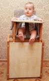 Adorable baby on highchair, at home Stock Photography