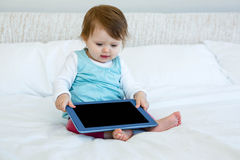 adorable baby holding aa tablet computer Stock Image