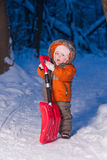 Adorable Baby Holding Snow Shovel On Road Royalty Free Stock Image