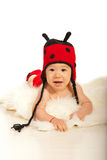 Adorable baby in ladybug hat Royalty Free Stock Images