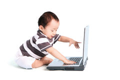 Adorable baby and laptop Stock Images