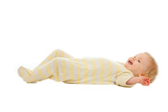 Adorable baby laying on floor isolated on white Royalty Free Stock Photo