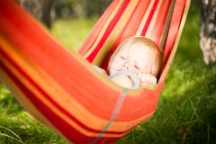 Adorable Baby Lie In Hammock Resting Under Trees Stock Images