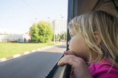 Adorable baby look at window riding on bus Stock Photo