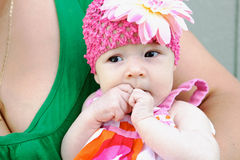 Adorable baby looking away from camera Royalty Free Stock Images