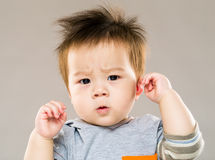 Adorable baby looking confused Stock Photography
