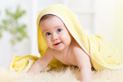 Adorable baby looking out under towel Royalty Free Stock Photo