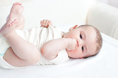 Adorable baby lying on the back Stock Photo