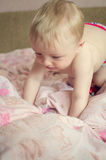 Adorable baby lying on the bed Royalty Free Stock Images