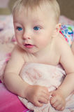 Adorable baby lying on the bed Royalty Free Stock Photography