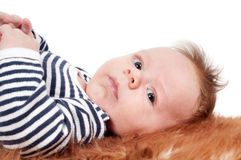 Adorable baby lying on fur Royalty Free Stock Photography