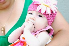 Adorable Baby Making Funny Face Stock Photo