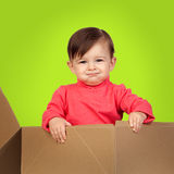 Adorable baby out of a package Royalty Free Stock Images