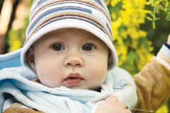 Adorable baby outdoors. On spring time Royalty Free Stock Photo