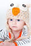 Adorable Baby in Owl Hat Stock Image