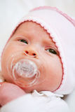 Adorable baby with pacifier Stock Images
