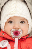 Adorable baby with pacifier Stock Photos