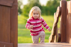 Adorable baby play on playground Royalty Free Stock Image