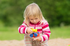 Adorable baby play with toys Stock Photography