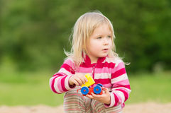 Adorable baby play with toys Stock Photos