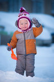 Adorable baby play on winter playground Stock Images
